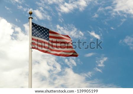 American Flag Blue Sky - stock photo