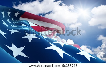 American flag closeup on blue sky - stock photo