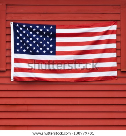 American flag displayed on red wooden wall - stock photo