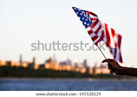 American flag during Independence Day on the Hudson River with a view at Manhattan - New York City (NYC) - United States of America - stock photo