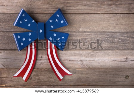 American flag emblem on a wooden background - stock photo