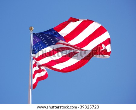 American flag flapping in the breeze - stock photo