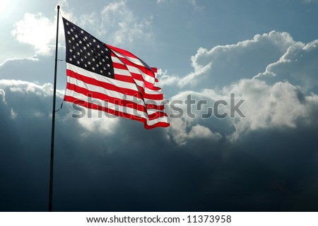 American Flag Flies Before a Stormy Sky - stock photo