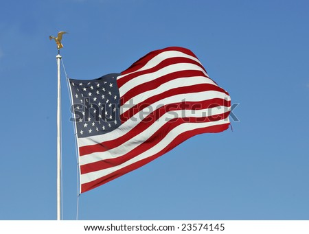 American flag flying in a strong wind - stock photo