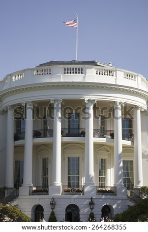 American Flag flying over pillars of the South Portico of the White House, the Truman Balcony, in Washington, DC on May 7, 2007,attended by Queen Elizabeth II and President George W. Bush - stock photo