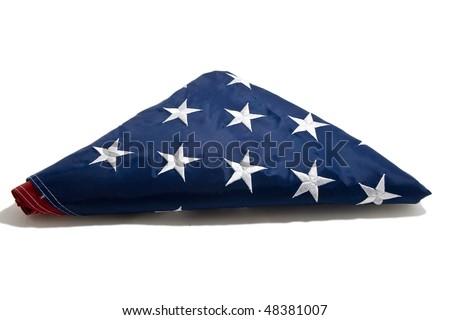 American flag folded on white background - stock photo