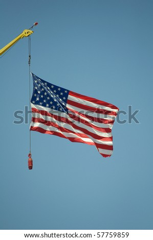 American flag held by a crane at the state fair - stock photo