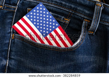American flag in a pocket of blue jeans. Close up.