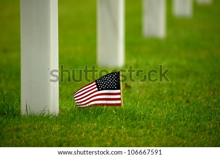american flag in american cemetery - stock photo