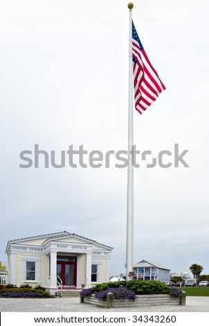 American flag in front of a post office in Seaside Florida USA - stock photo
