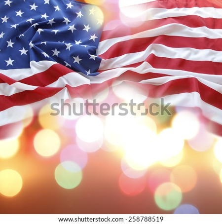 American flag in front of abstract background - stock photo