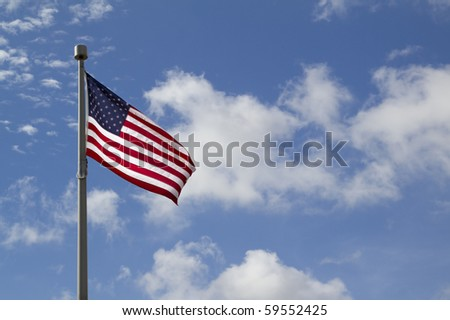American flag in front of blue sky