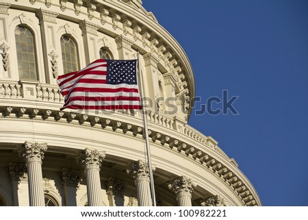 American flag in front of US Capitol dome