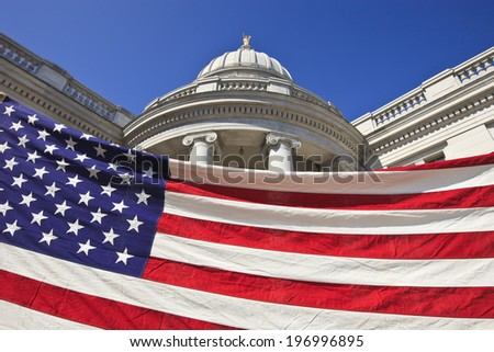 American flag in front of Wisconsin State Capitol Building during a protest - stock photo
