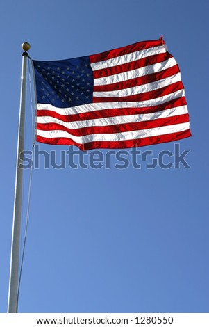 American flag in strong breeze.