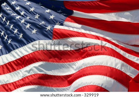 American flag in the wind. - stock photo
