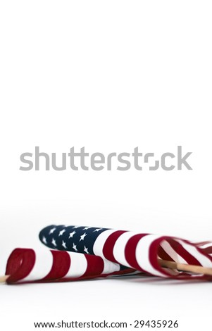 American flag laying down on white background