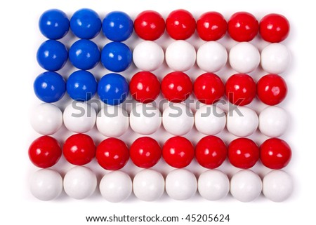 American Flag made of gumballs on white background