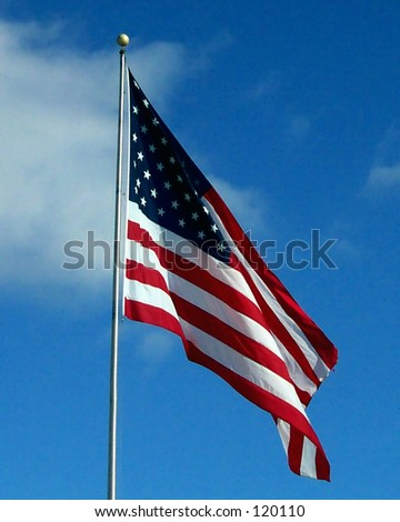 American Flag on a Bright Blue Winter Day - stock photo