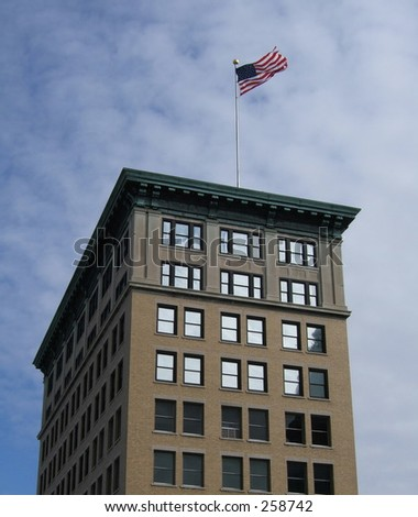 american flag on a building - stock photo
