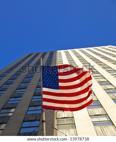 American flag on a skyscraper in New York