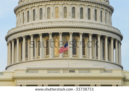 American flag on dome of US Capitol Building in Washington, DC