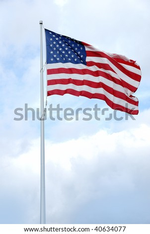 American flag on flag pole undulating in the wind
