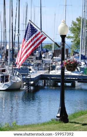 American Flag on Lamppost in Bayfield, Wisconsin - stock photo