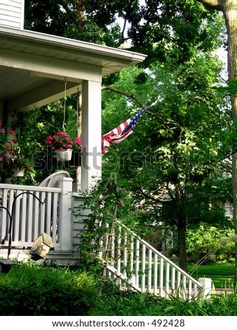 American flag on porch 2 - stock photo