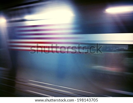 American flag on subway car traveling in motion underground in New York City with Instagram effect filter. - stock photo