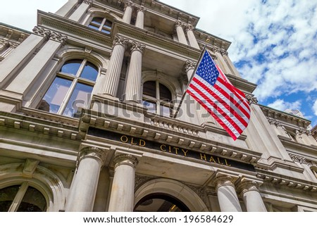 American flag on the Old City Hall building in Boston, Massachusetts, USA