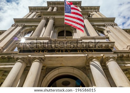 American flag on the Old City Hall building in Boston, Massachusetts, USA - stock photo