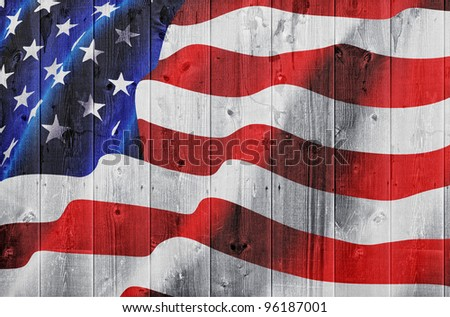 American flag on wooden hedge - stock photo