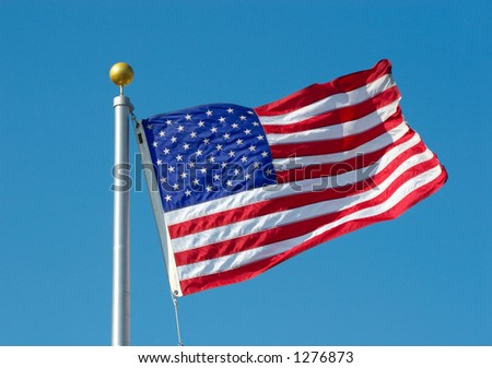 American flag over blue sky - stock photo