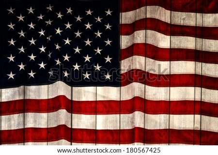 American flag painted on wood wall background - stock photo