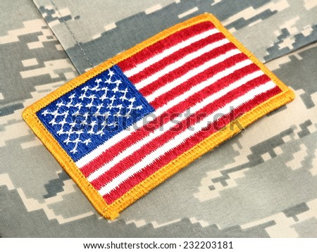 American Flag patch on camouflage uniform - stock photo