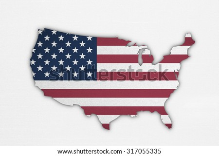 American flag pattern in country map shape on cotton fabric texture textile on white cloth: United States of America map with white/ red stripes and stars on blue patterned flag in vintage tone