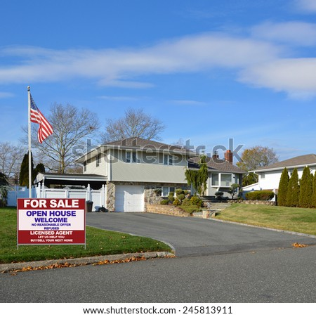 American flag pole Real estate for sale open house welcome sign Suburban High Ranch Home with Siding and Stone Landscaped beautiful sunny blue sky clouds residential neighborhood USA - stock photo