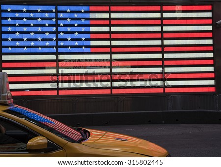American Flag reflected on the windshield of a taxi