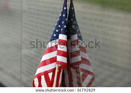 American flag rests against the Vietnam Wall in Washingotn DC - stock photo