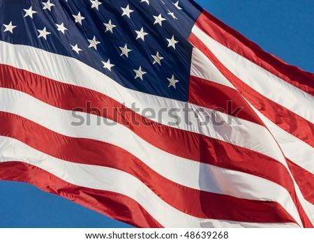 American Flag rippled by a breeze. - stock photo
