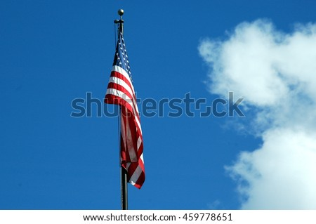 American flag standing tall outdoors.