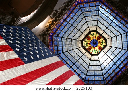American flag upwards to stained glass skylight - stock photo
