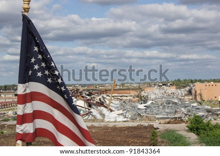American Flag Waiving After Tornado - stock photo