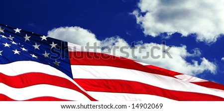 american flag waving against deep blue clouds background - stock photo