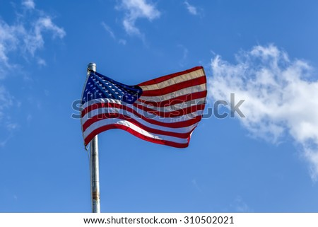 American flag waving in the wind. - stock photo