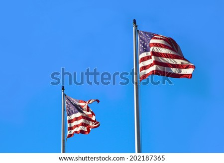 American flag waving on blue sly. Retro background. Fourth of July - stock photo
