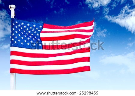 American flag with a sky as a background