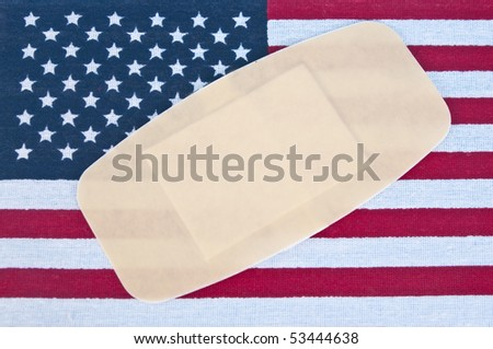 American Flag with Bandage for Concept of America Wounded.