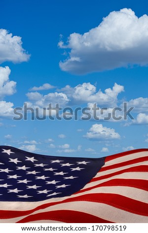 American flag with blue sky. - stock photo